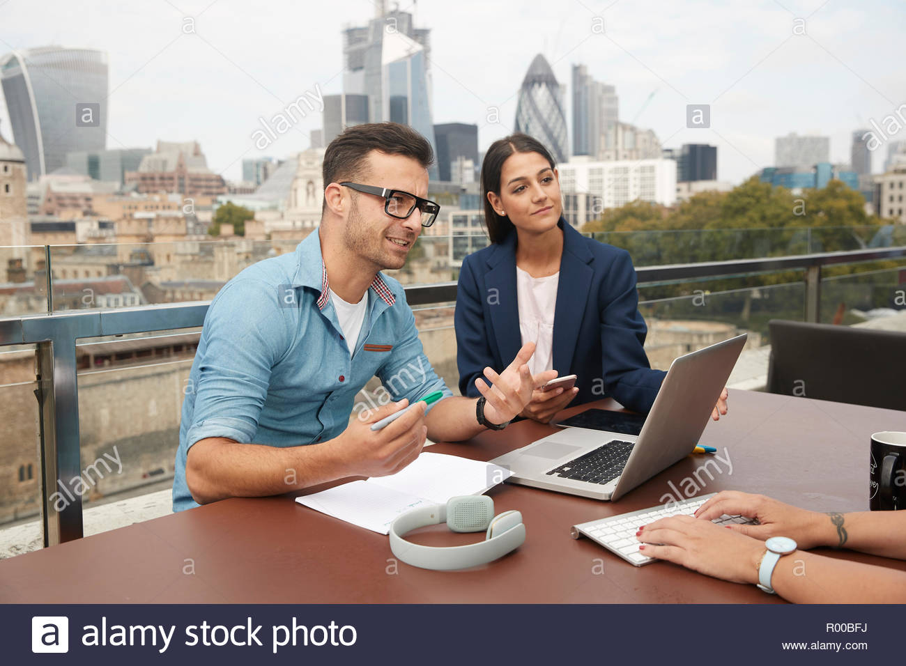 Businesspeople during meeting on balcony Stock Photo
