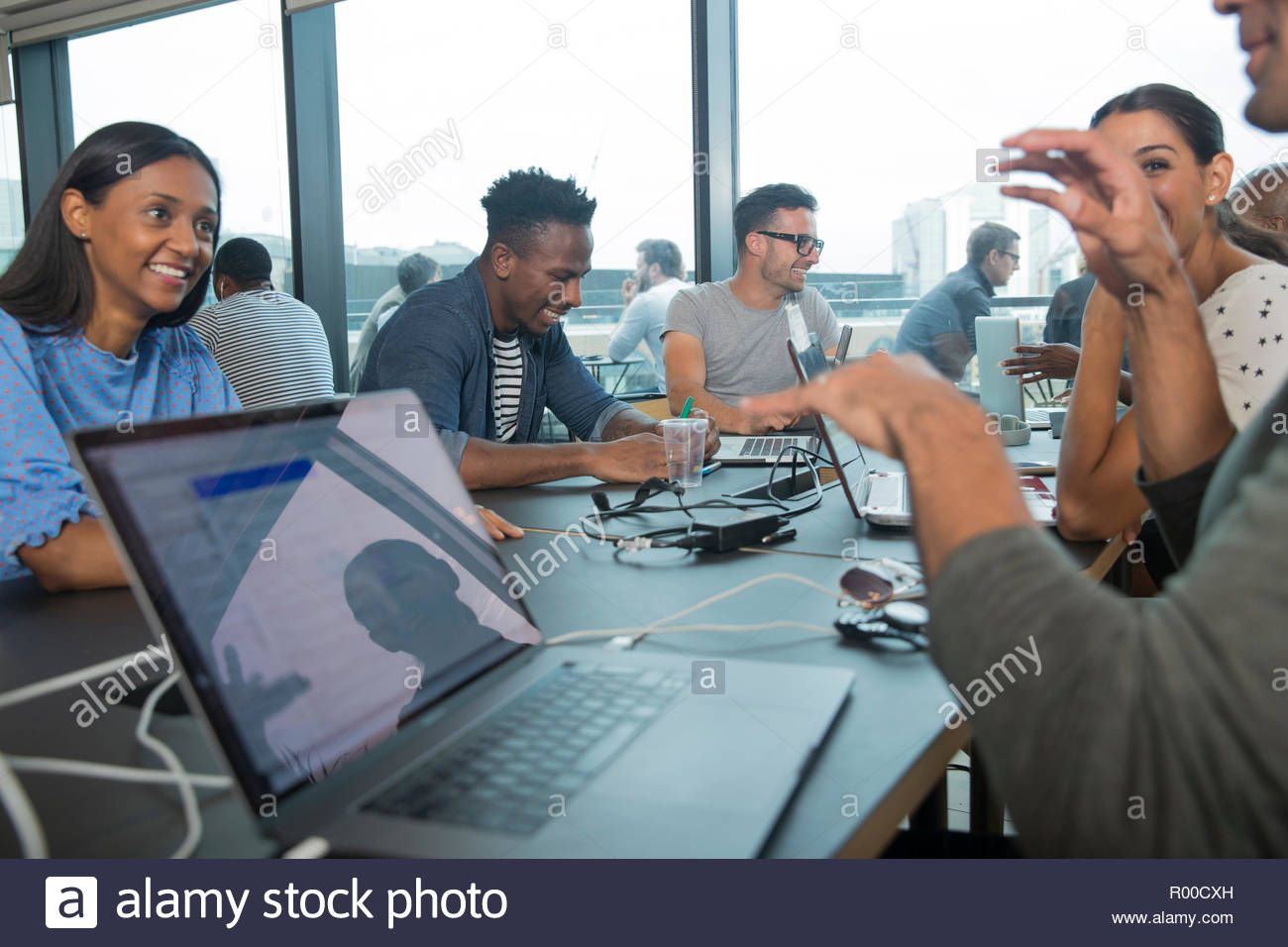 Colleagues using laptops during meeting Stock Photo