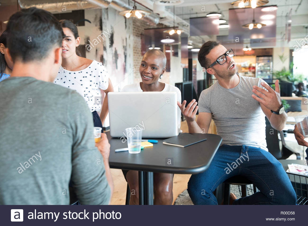 Colleagues talking at table Stock Photo
