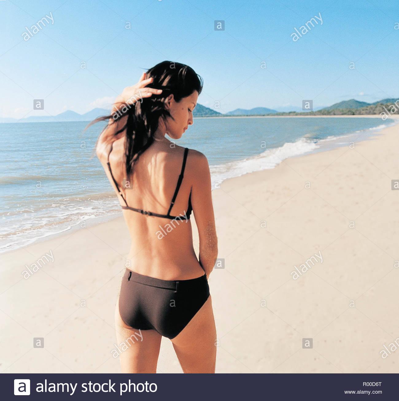 Woman wearing black bikini on beach Stock Photo