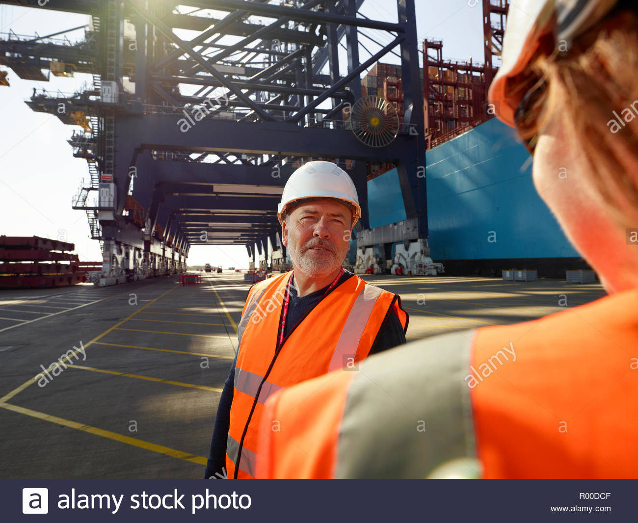 Dock workers by cargo ship at Port of Felixstowe, England Stock Photo