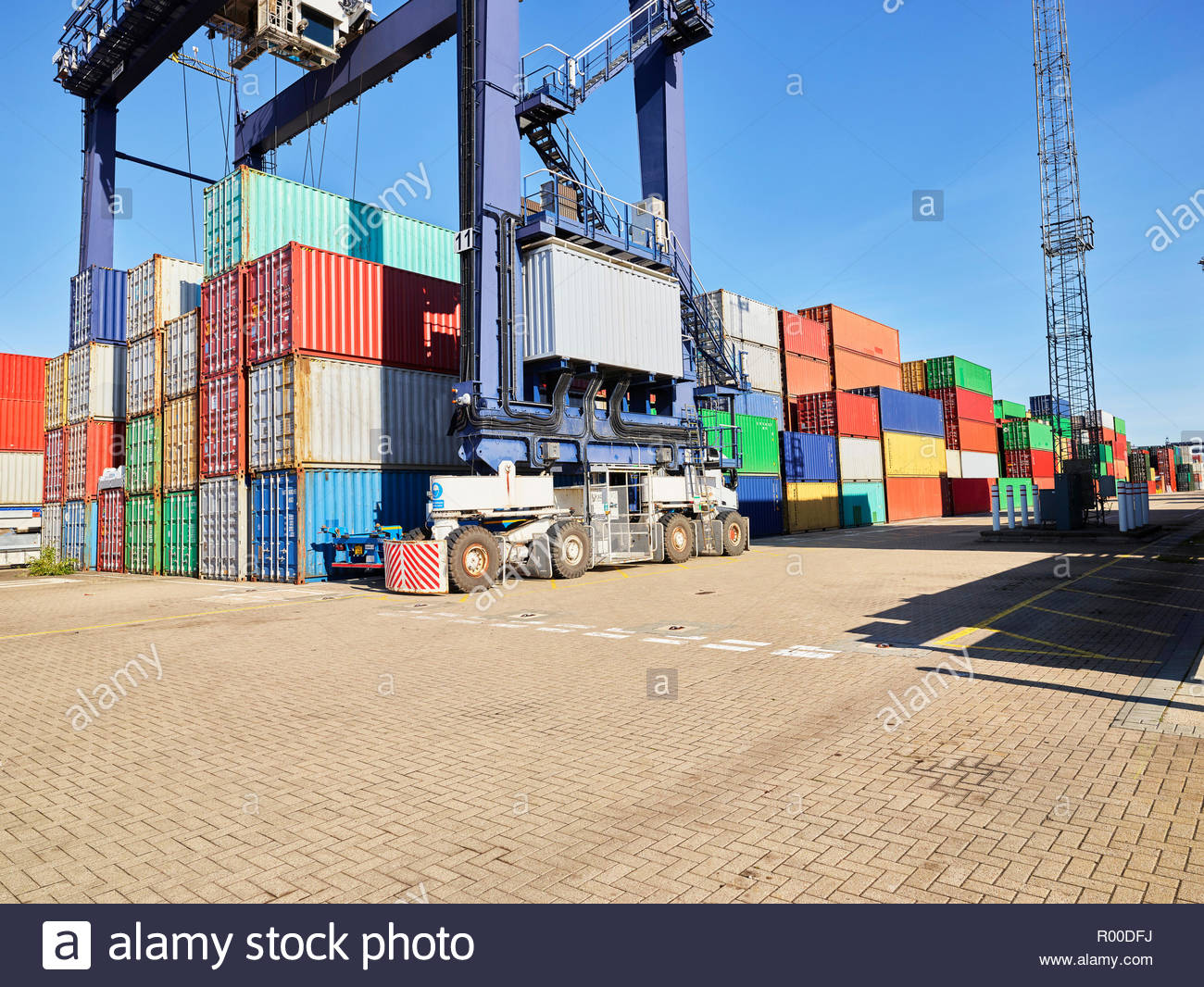 Crane and stacks of cargo containers at Port of Felixstowe, England - Stock Image