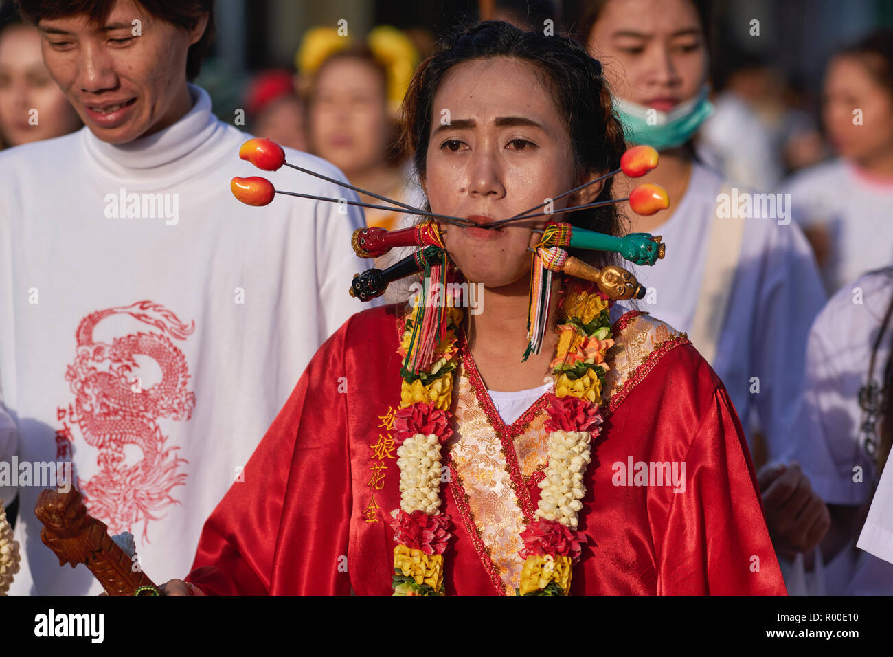 A Mah Song or spirit medium displays a pierced cheek during the annual Vegetarian Festival in Phuket, Thailand, in honour of the Chinese Emperor Gods - Stock Image