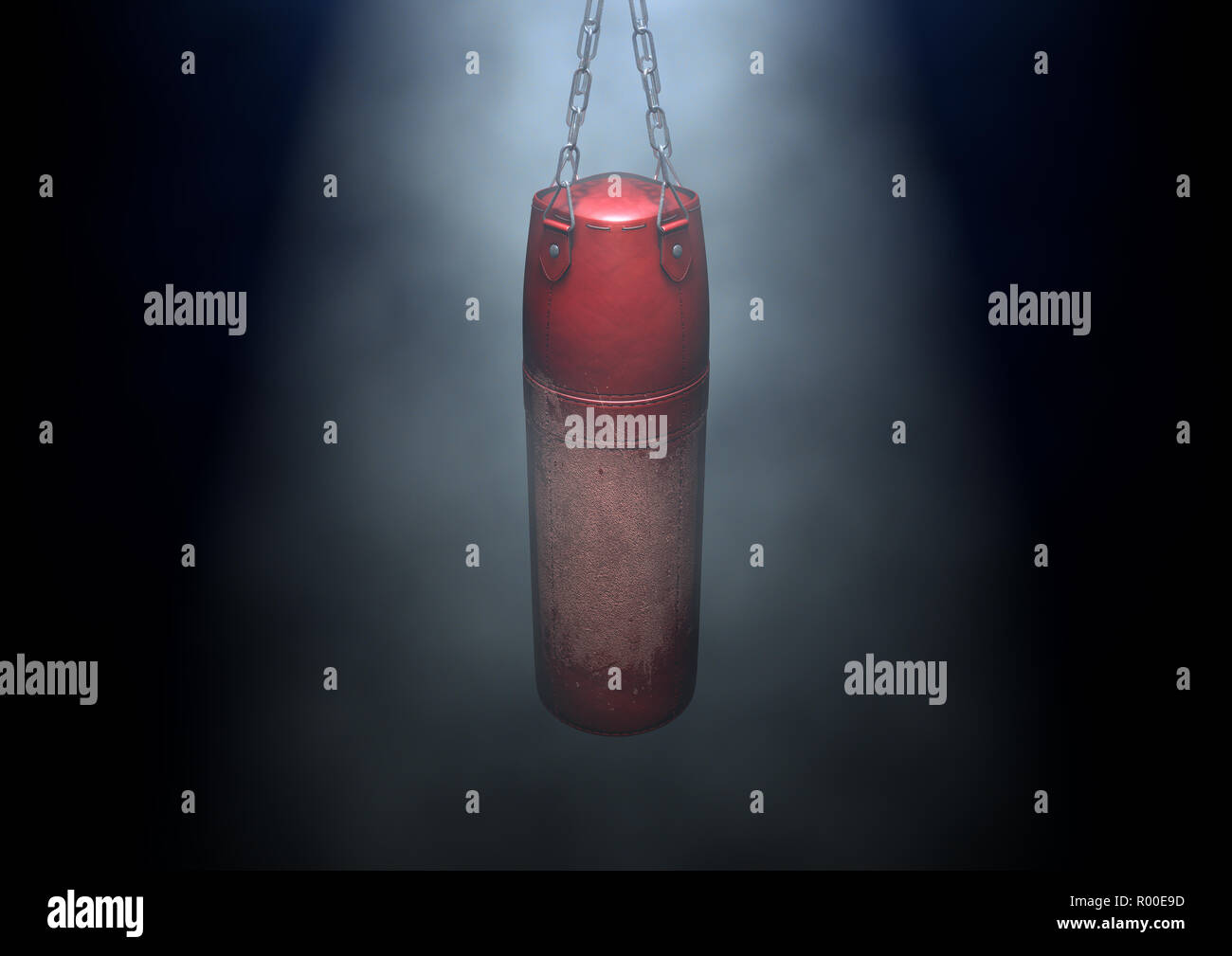 An old worn red leather punching bag hanging by chains in a  dark room lit by an ethereal spotlight - 3D render - Stock Image