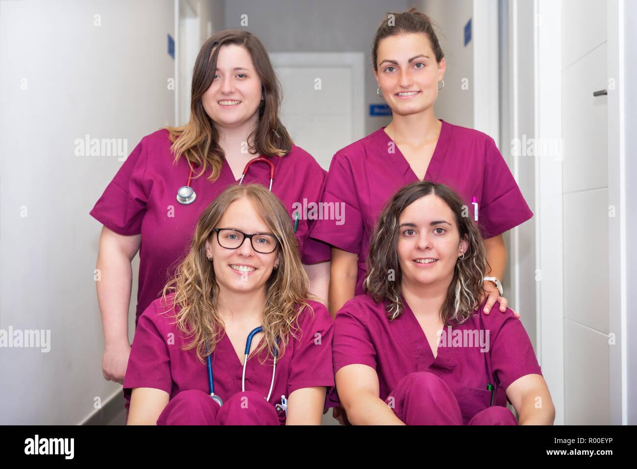 Cheerful woman veterinary team - Stock Image