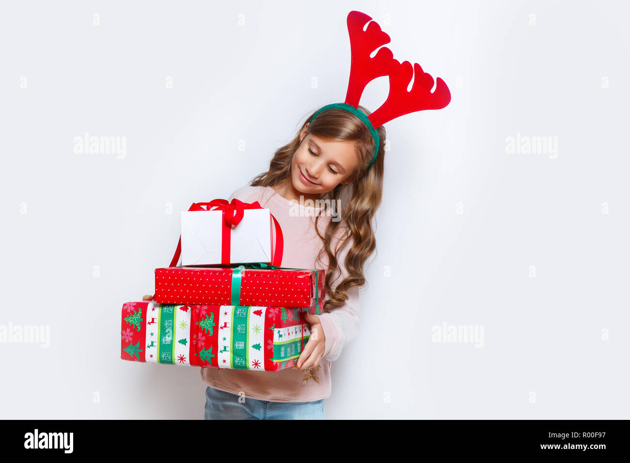 Happy little smiling girl with christmas gift box. Happy little ...