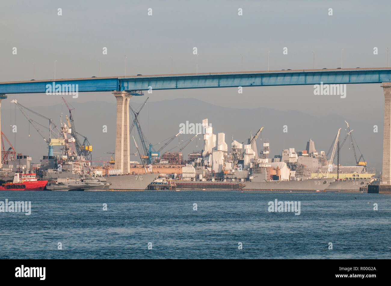 USS Higgins (76) and other destroyers getting refit in Naval dockyards, San Diego Harbor, San Diego, California. - Stock Image