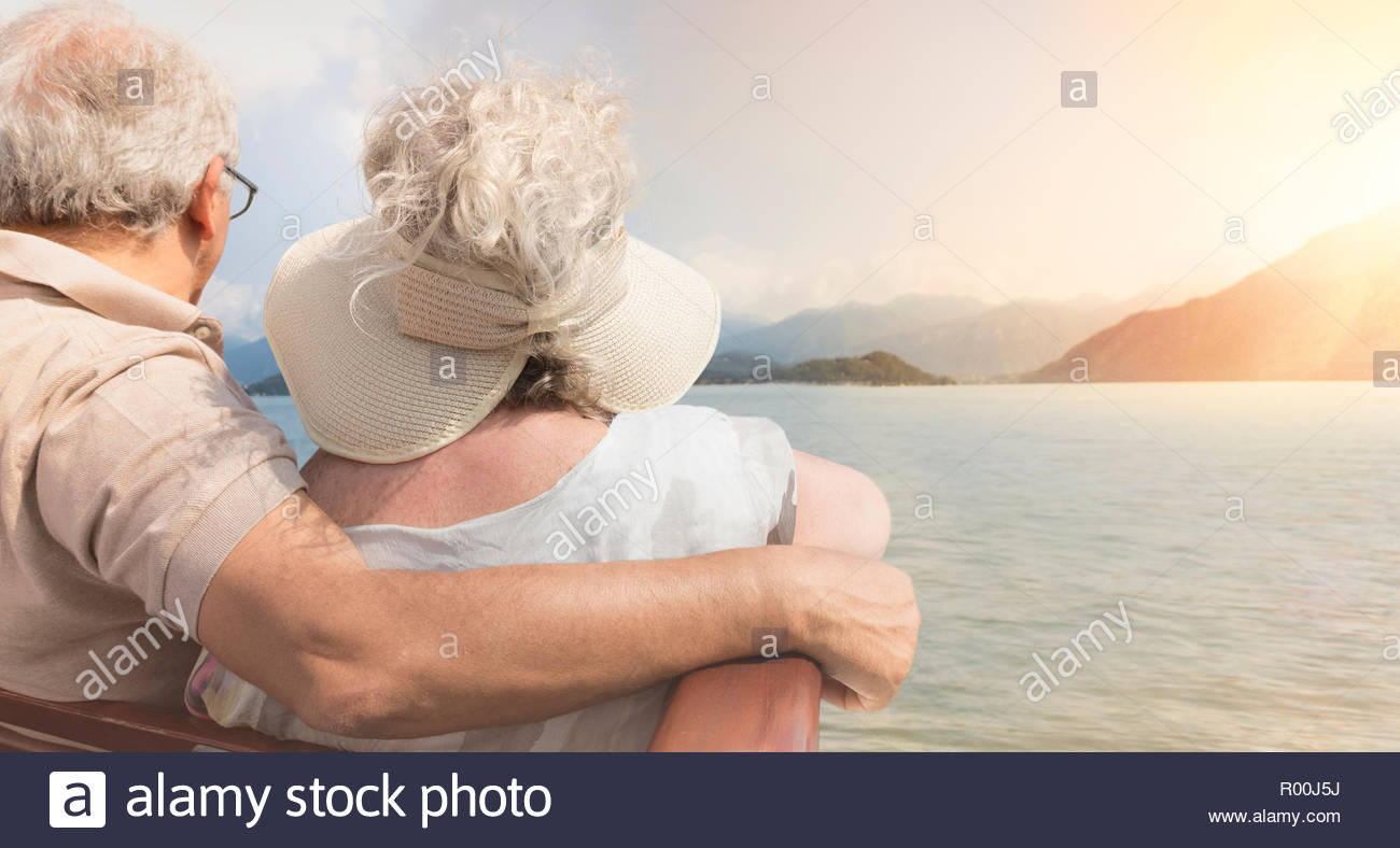 Senior couple watching sunset - Stock Image