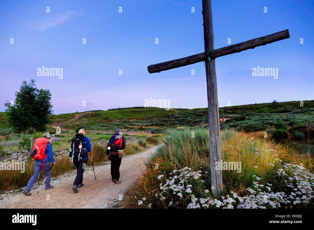 Camino de Santiago (Spain) - Pilgrims  walking along the way of St.James in the Bierzo landscape Stock Photo