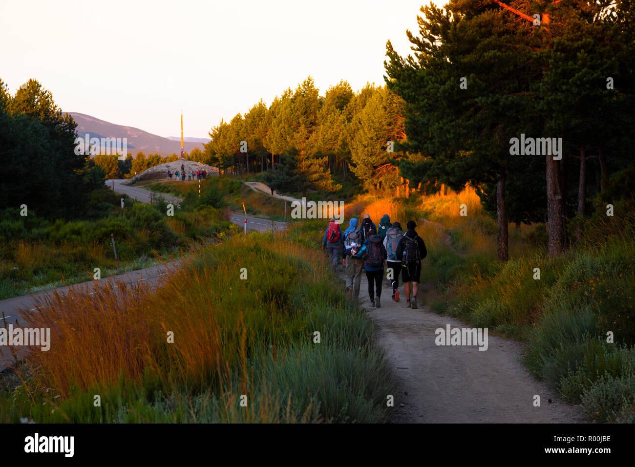 Camino de Santiago (Spain) - Pilgrims in the sunshine walking along the way of St.James Stock Photo