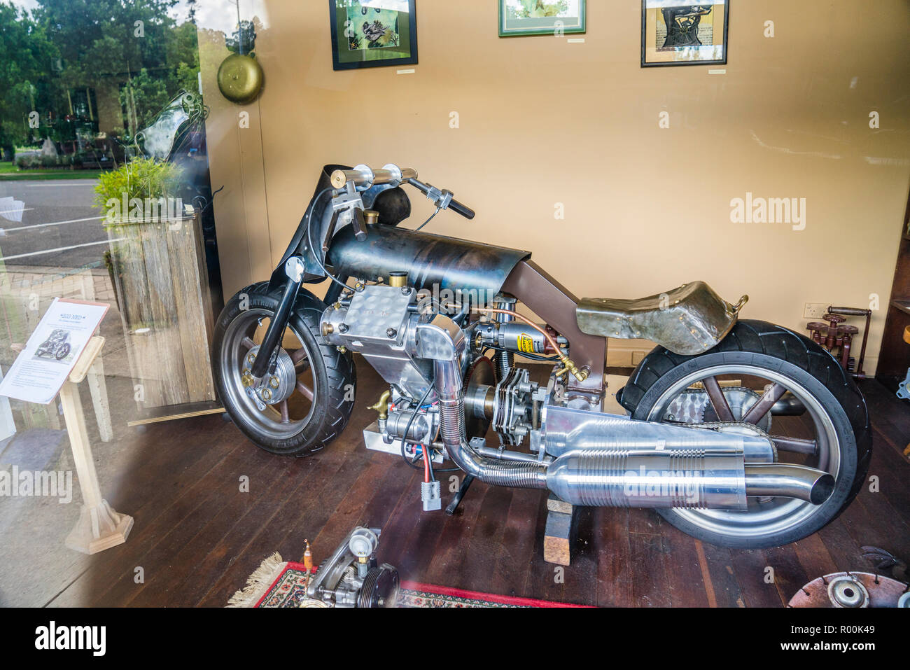 handcrafted motorbike titled 'Big Ned' the ultimate street fighter at the Makers of Metal gallery cafe at the Northern Tablelands country town of Walc - Stock Image