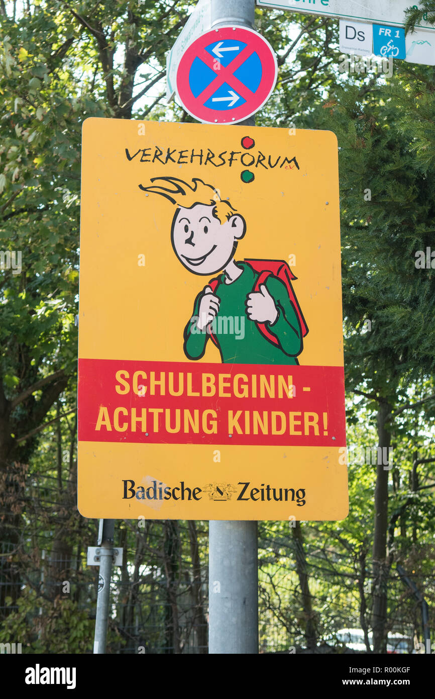 sign alerting drivers that it is the beginning of the school year and to pay attention to pupils by the side of the road Freiburg im Breisgau, Germany - Stock Image