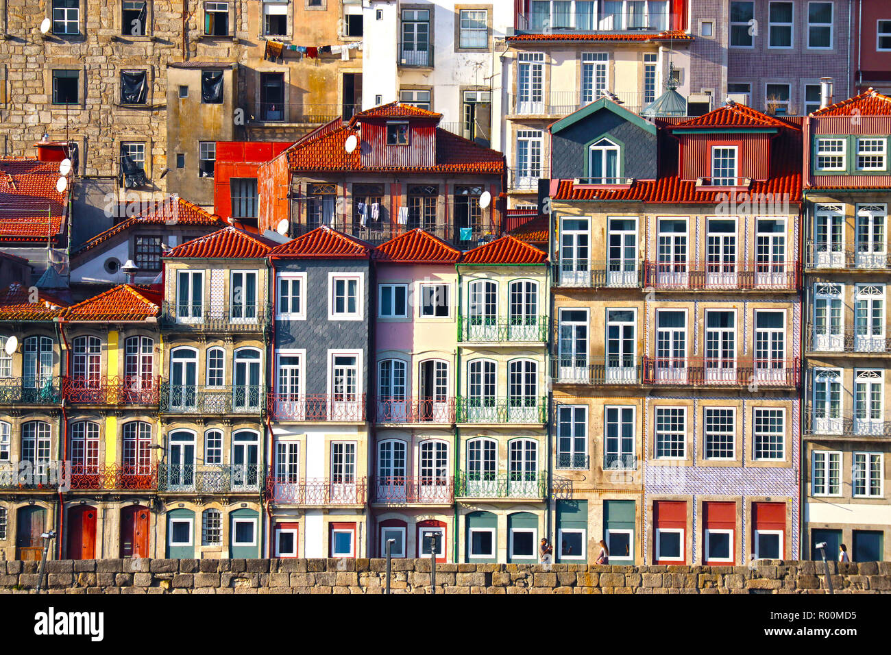 An abstract image depicting period houses complete with Azujelo tiles and ornate balconies, along the Douro River Front in Porto, Portugal - Stock Image