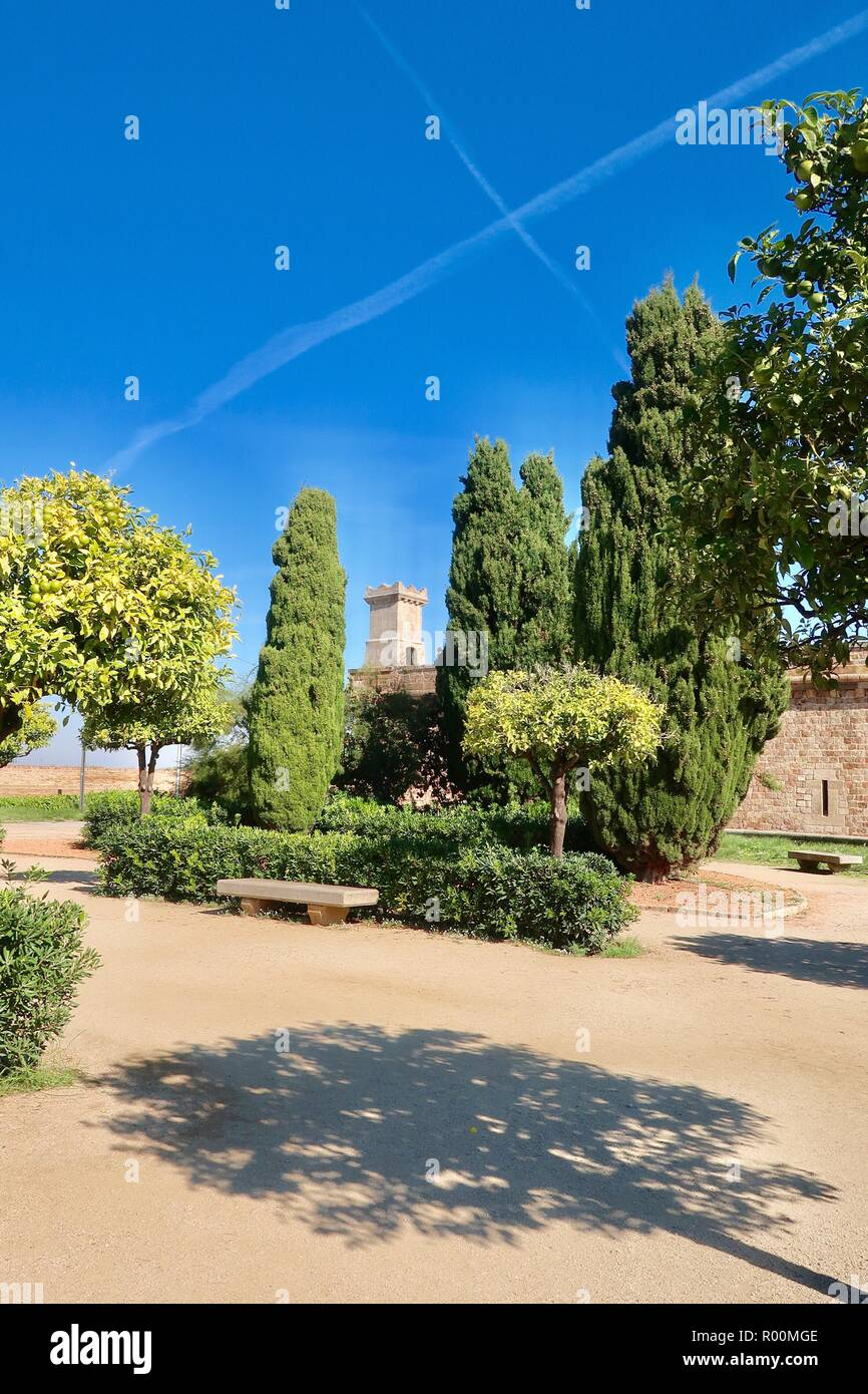 Barcelona, Spain, October 2018. Light and shade in the gardens of Castell / Castle Mont Juic on a hot bright afternoon. - Stock Image