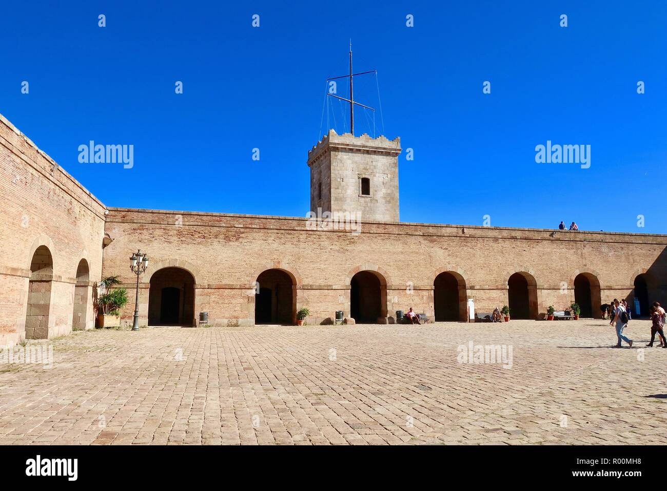 Barcelona, Spain, October 2018. People enjoying Castell / Castle Mont Juic on a hot bright afternoon. - Stock Image
