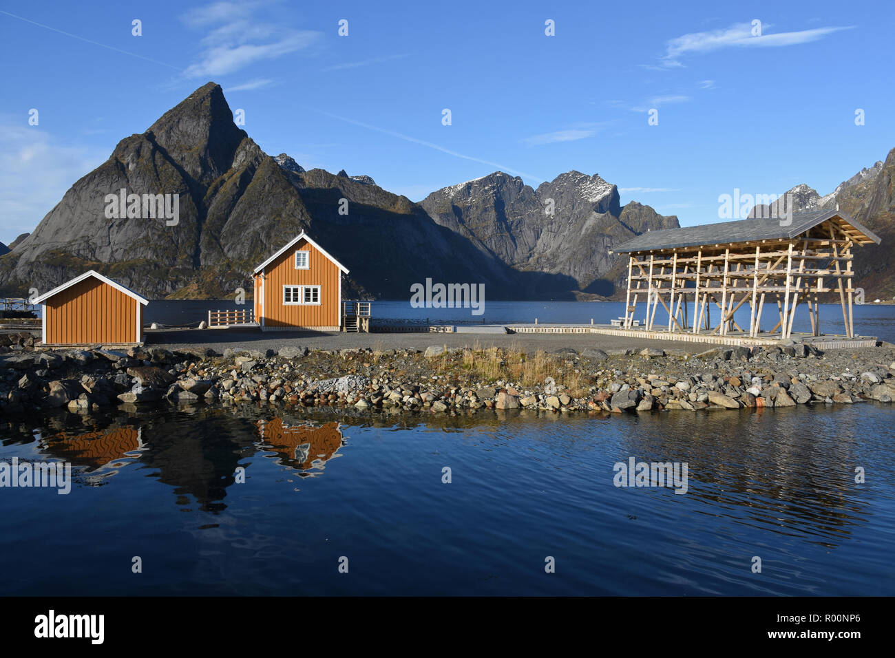 Yellow houses in Sakrisoy and Olstinden in the background, Lofoten, Norway Stock Photo