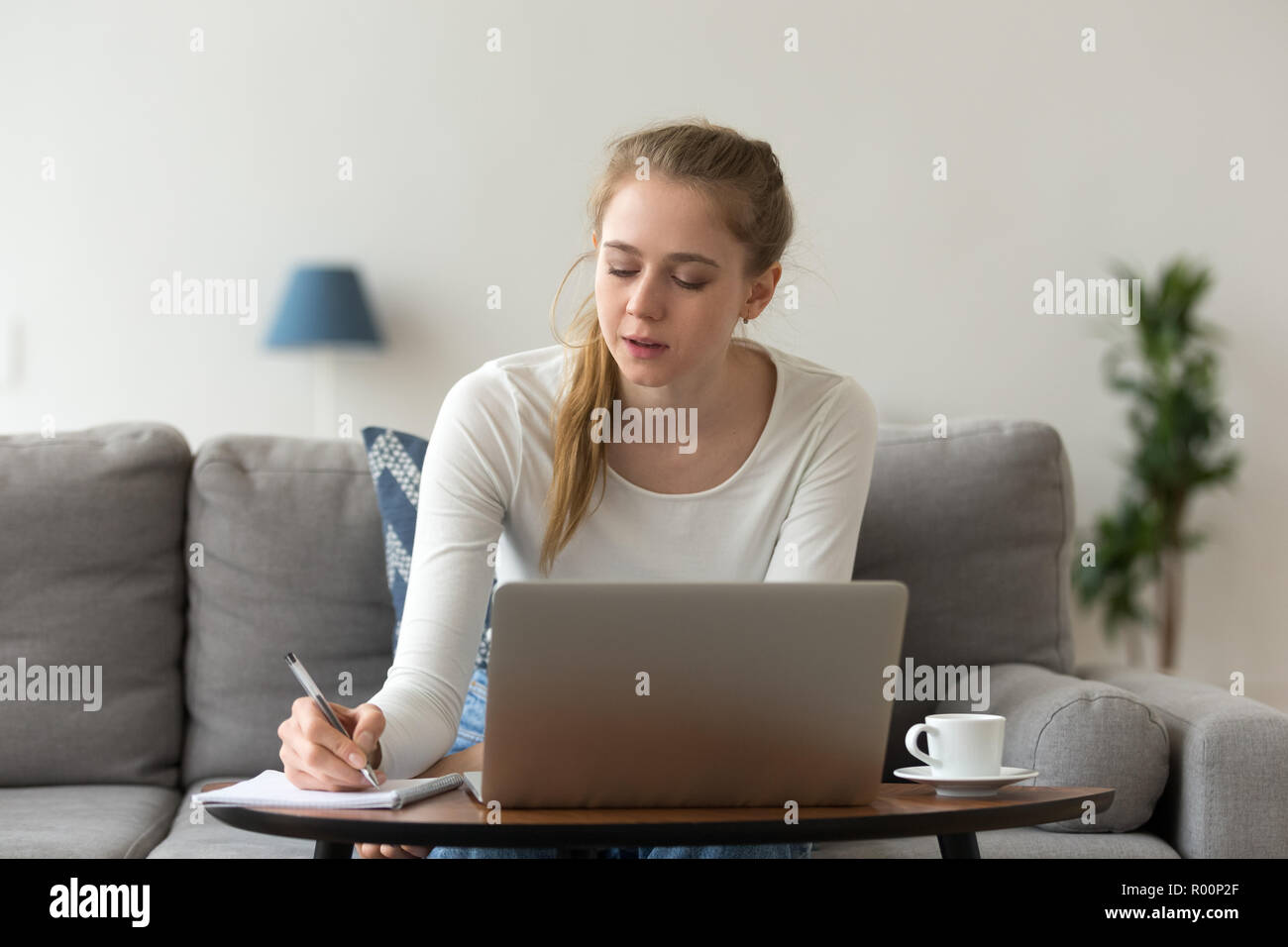 Woman studying learning or working at home - Stock Image