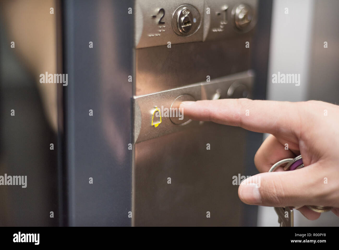 Pressing the alarm button in the elevator - Stock Image