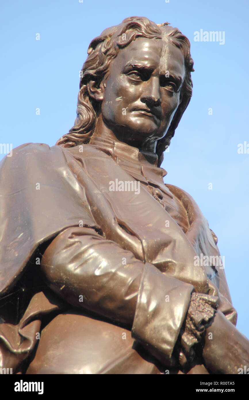 Statue of physicist and astronomer, Sir Isaac Newton in Grantham town centre, Lincolnshire, England, UK - Stock Image