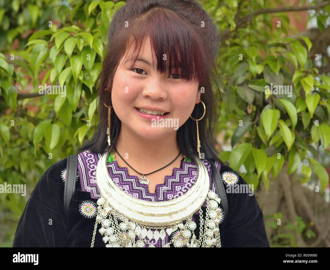 Vietnamese H'mong teenage girl wears her clan's traditional Sunday Best during the weekly market day. - Stock Image