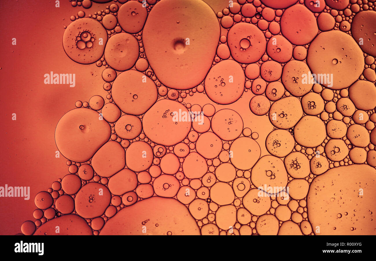 Macro photo of an oil drops on water surface looks like tissue under microscope. Stock Photo