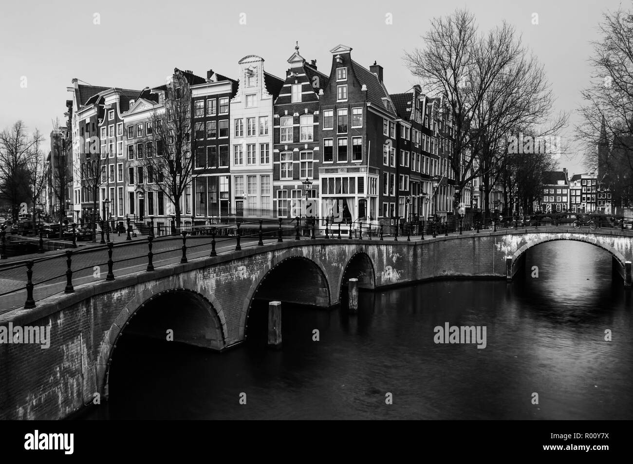 Amsterdam, Netherlands canals and bridges. Night view of Keizersgracht and famous touristic place. Black and white - Stock Image