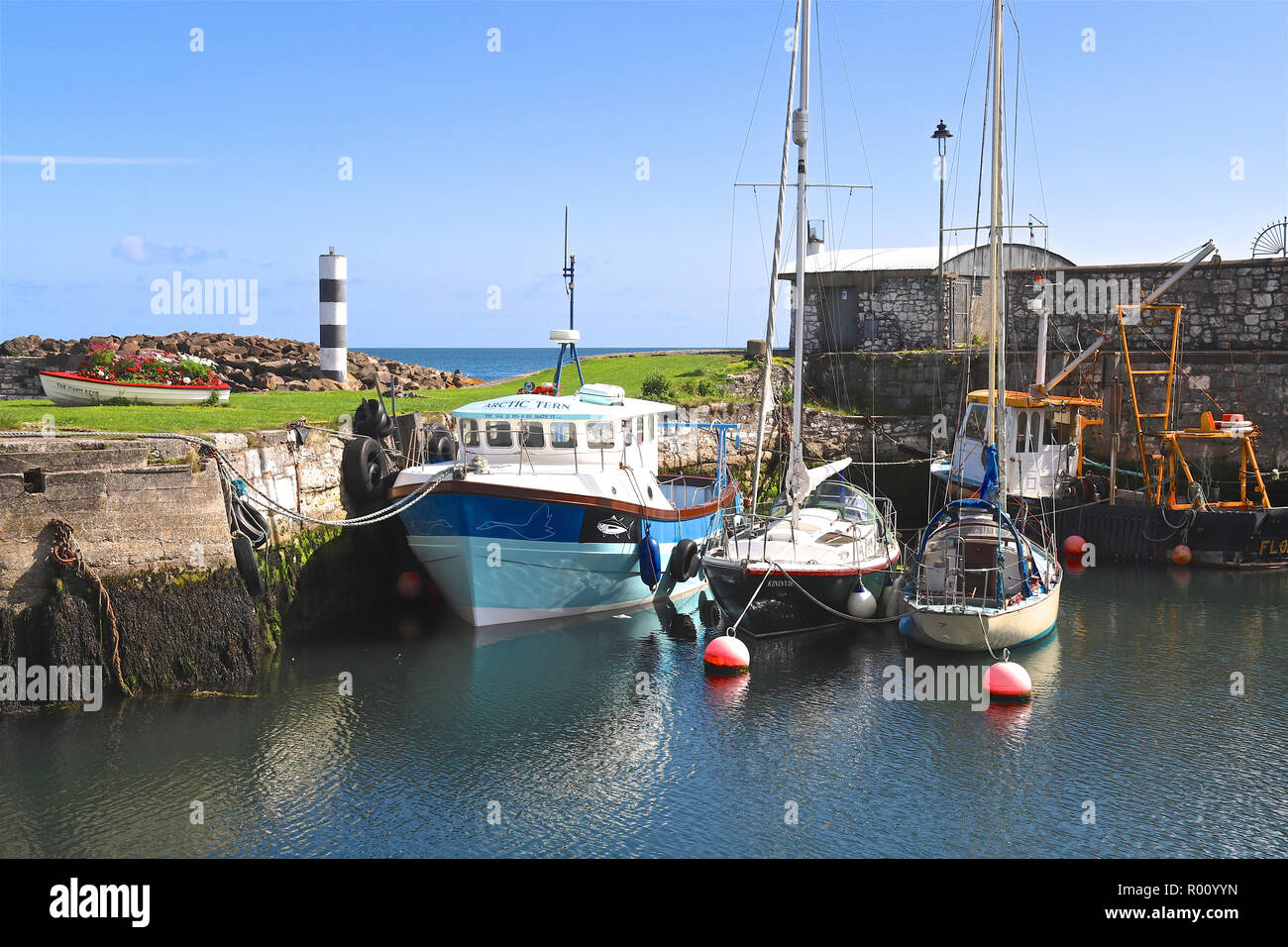 Boats lying in Carnlough Harbour, County Antrim, Northern Ireland, U.K. - Stock Image