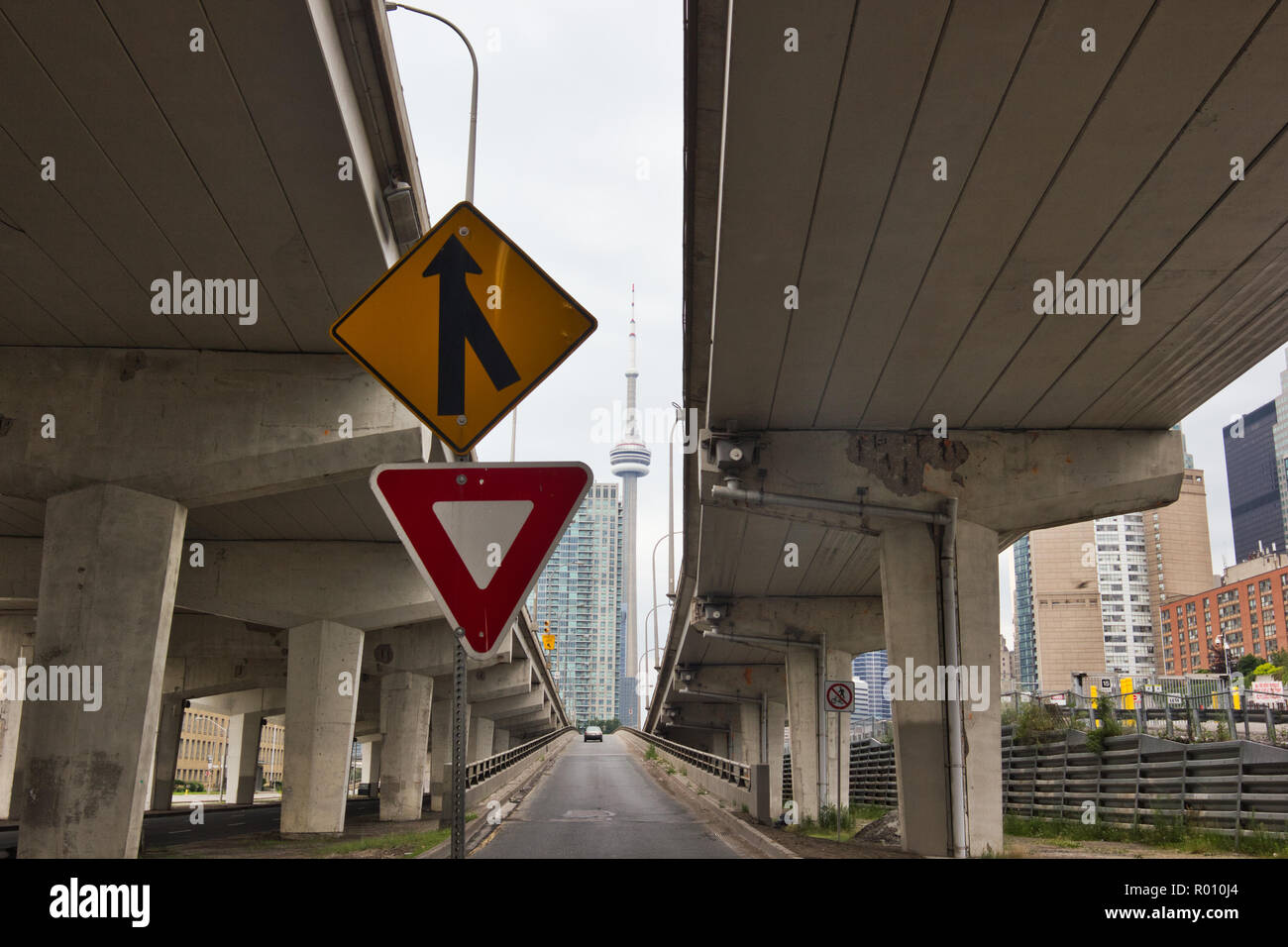 View of CN Tower from between two flyovers, Toronto, Ontario, Canada - Stock Image