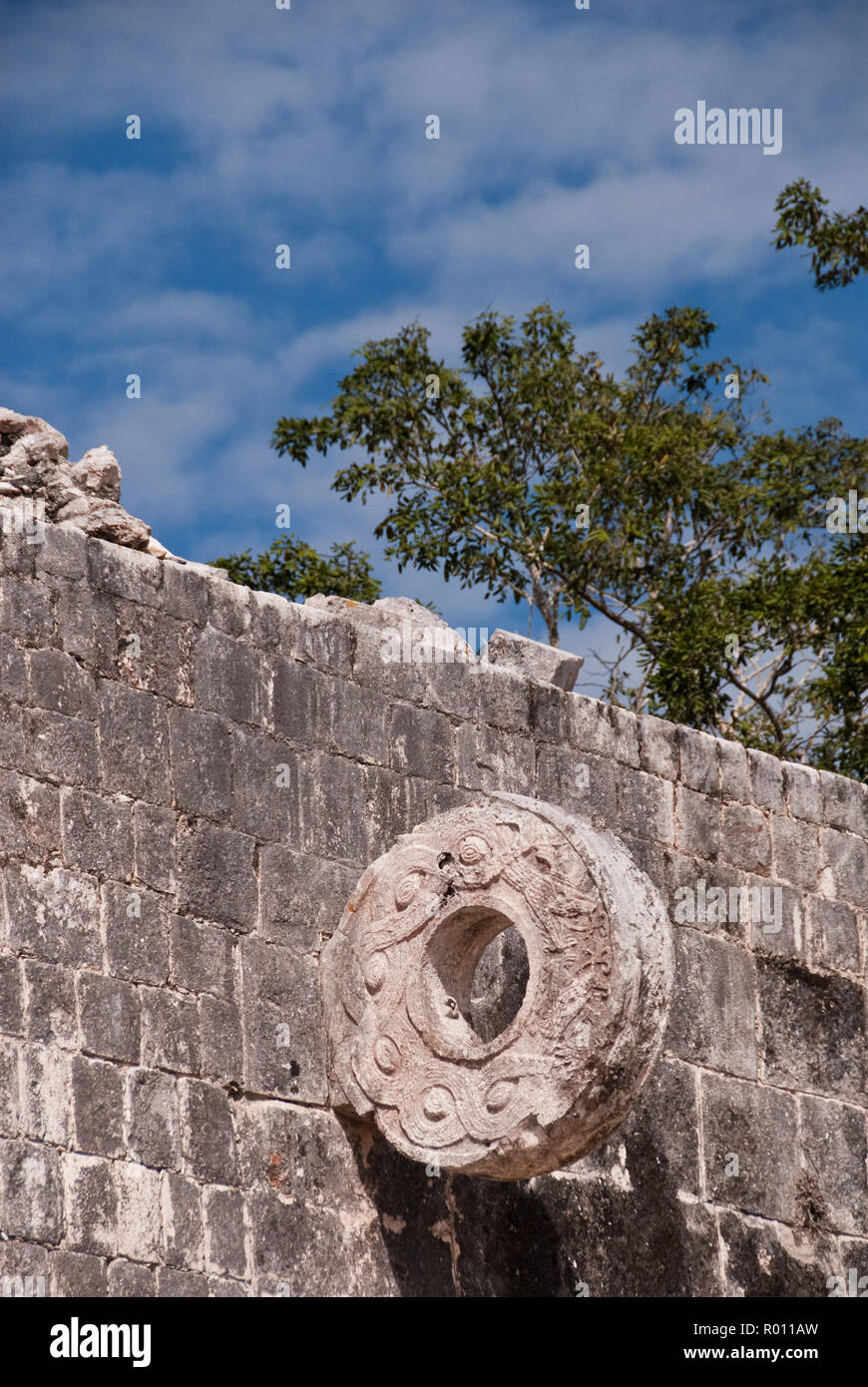 A stone ring at the Great Ball Court (Gran Juego de Pelota), used to play a Mesoamerican ballgame, Chichen Itza, Yucatan, Mexico. - Stock Image