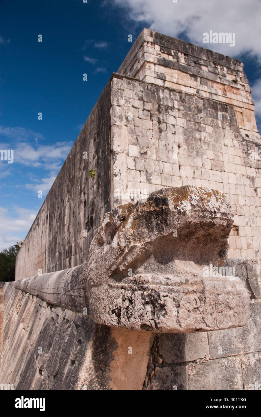 A Kukulkan sculpture (Feathered Serpent), the Maya snake deity, at the Great Ball Court (Gran Juego de Pelota), Chichen Itza, Mexico. - Stock Image