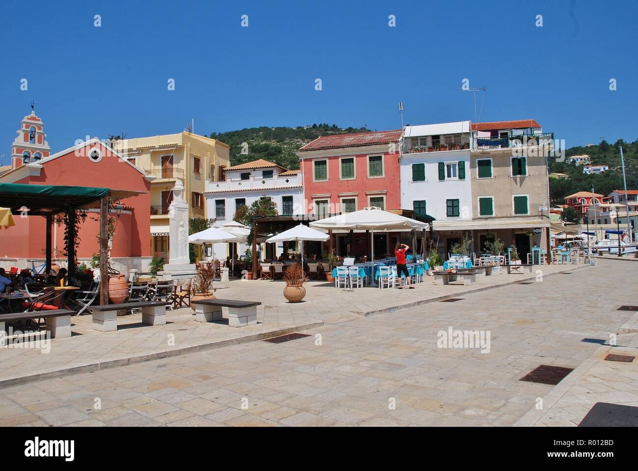 Harbour front tavernas at Gaios on the Greek island of Paxos on June 12, 2014. Gaios is the Capital of the 13km long island. - Stock Image