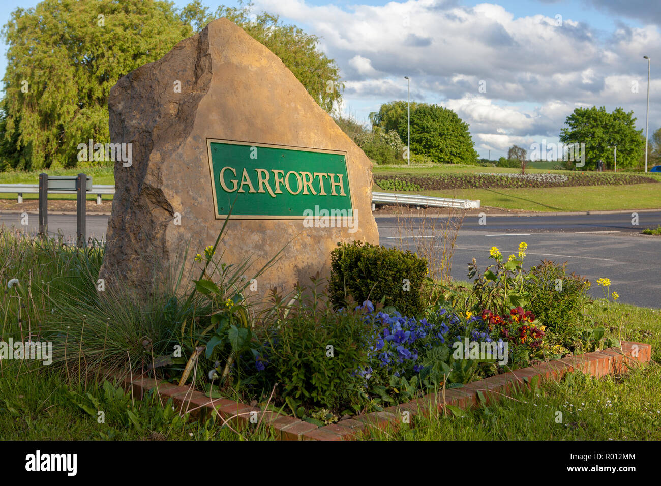 A substantial stone boundary sign for Garforth, near Leeds in West Yorkshire - Stock Image