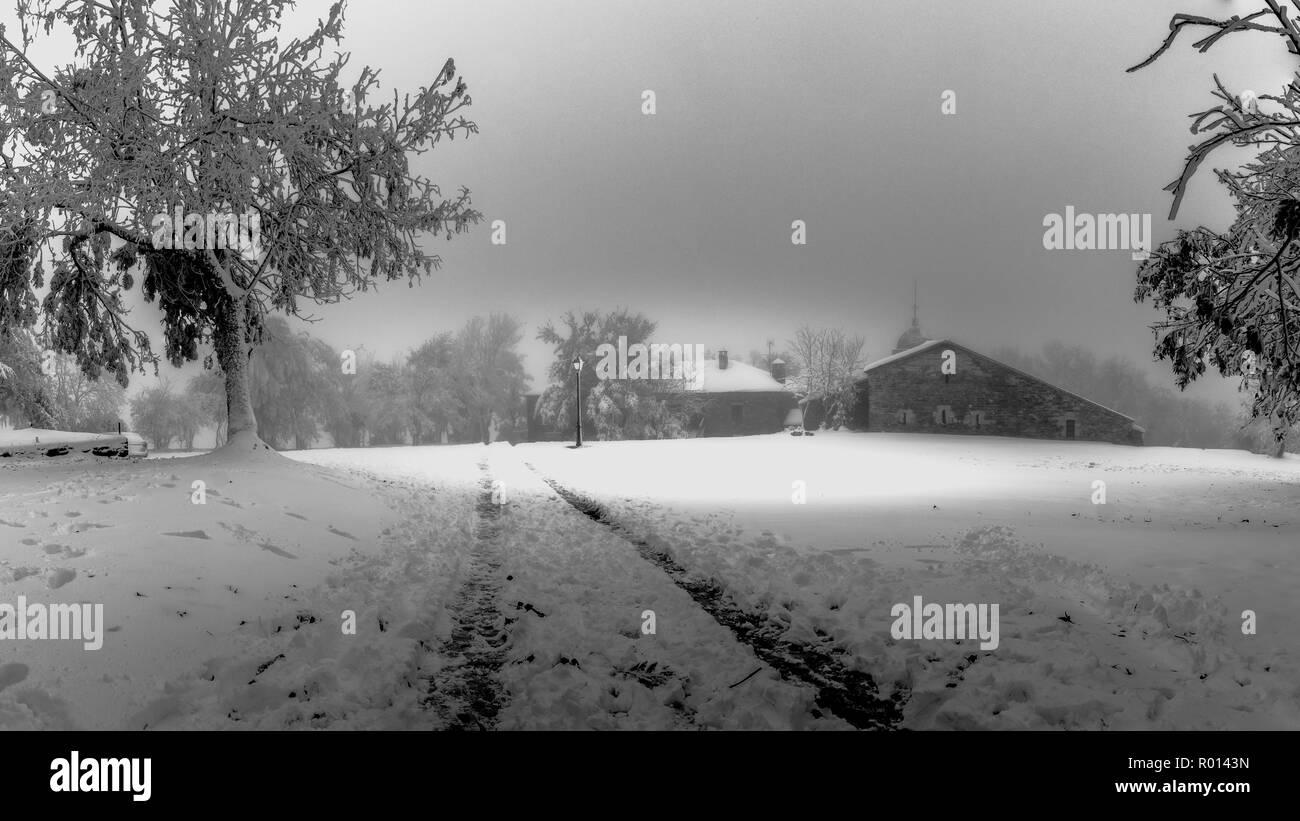 Black and white panoramic of O Cebreiro with Snow, Way of St. James, the Camino de Santiago - Stock Image