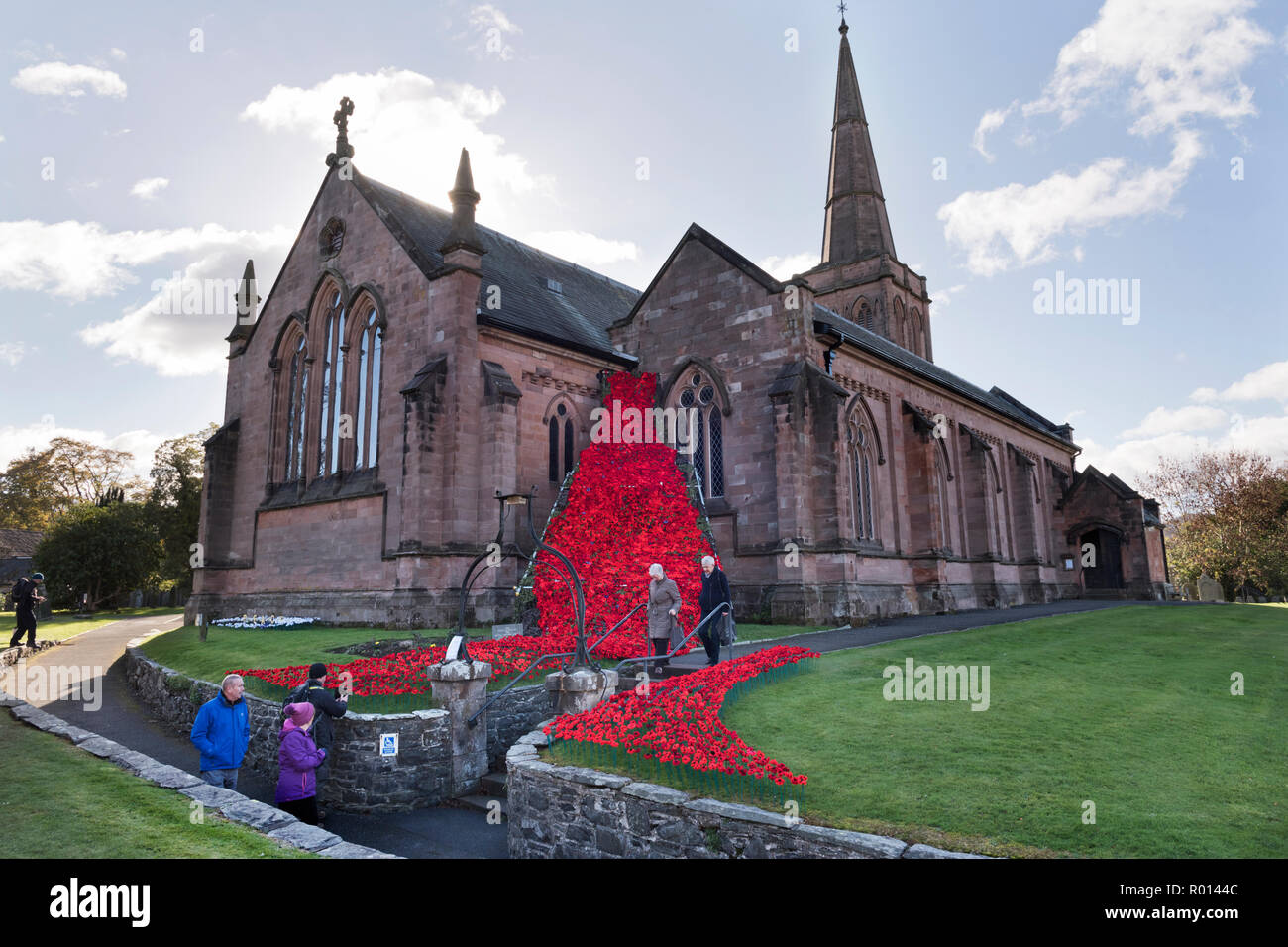Display of poppies for Remembrance Day at St John's Church, Keswick, Cumbria, UK - Stock Image