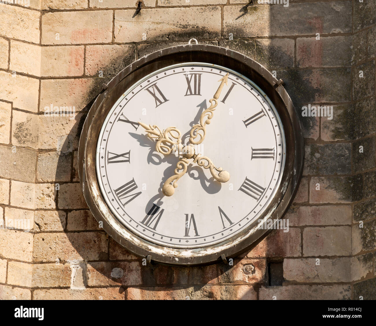 Clock face in the tower of the church of St Christopher, Coulanges-la-Vineuse, Yonne, France, Europe - Stock Image