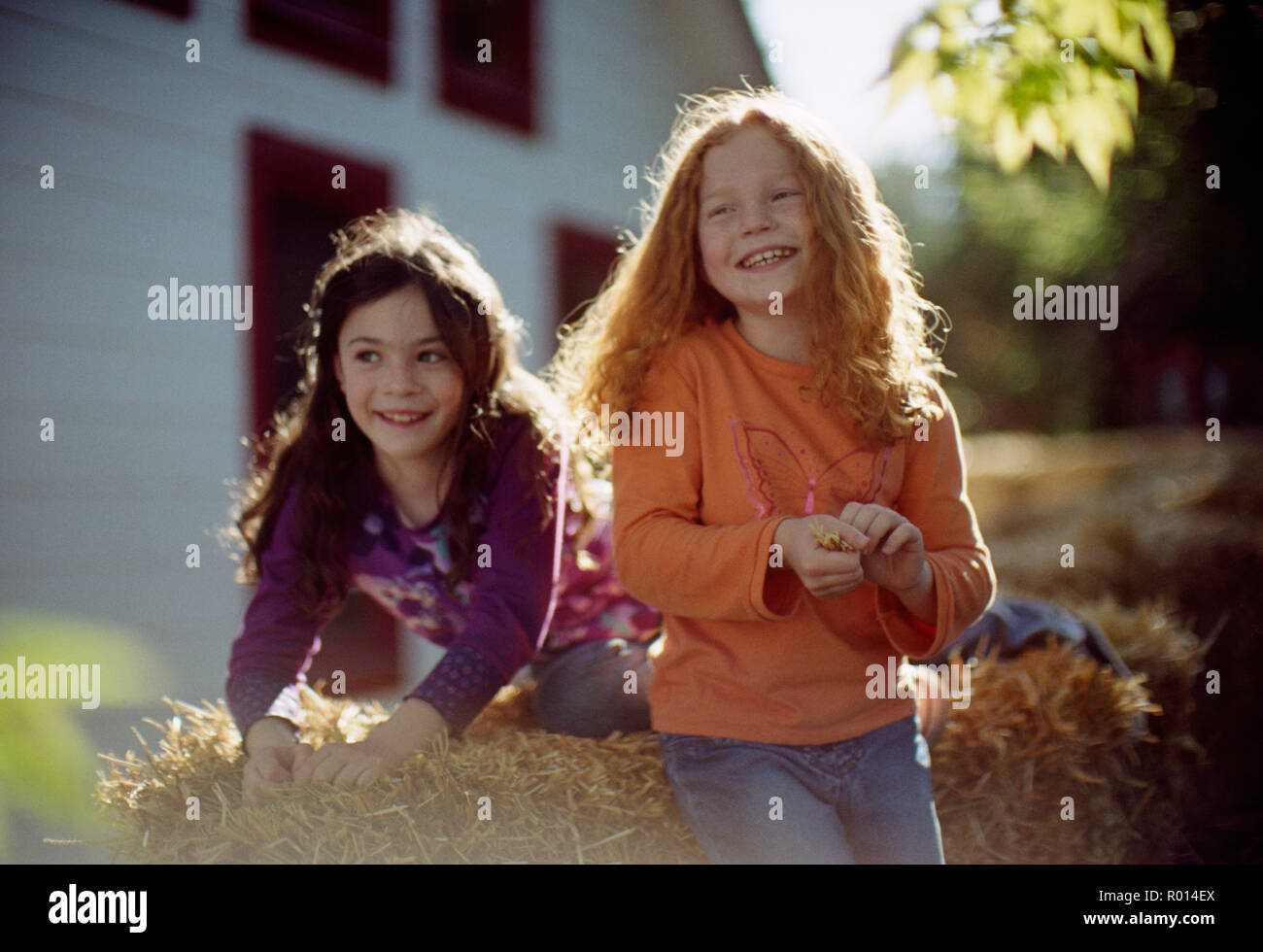 Two happy young girls playing together. - Stock Image