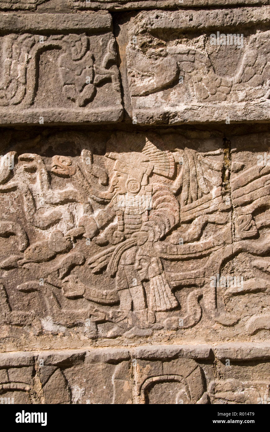 The stone skull platform (tzompantli), decorated with images of warriors carrying the severed heads of enemies, at Chichen Itza, Mexico. - Stock Image