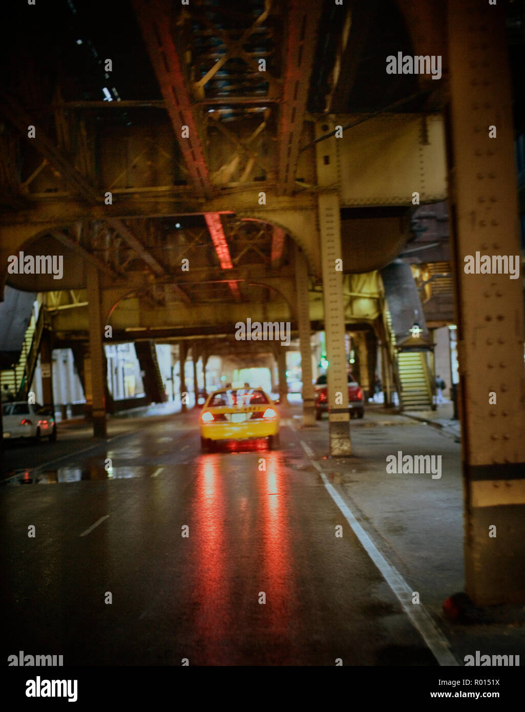 View of a cab moving on a wet road. Stock Photo