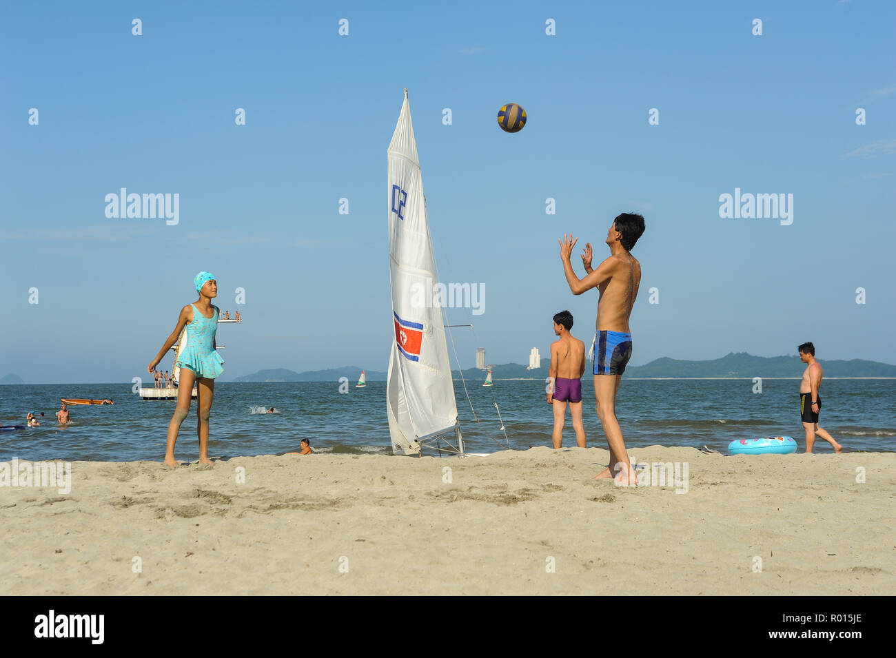 Wonsan, North Korea, beach holidaymaker at the ball game - Stock Image