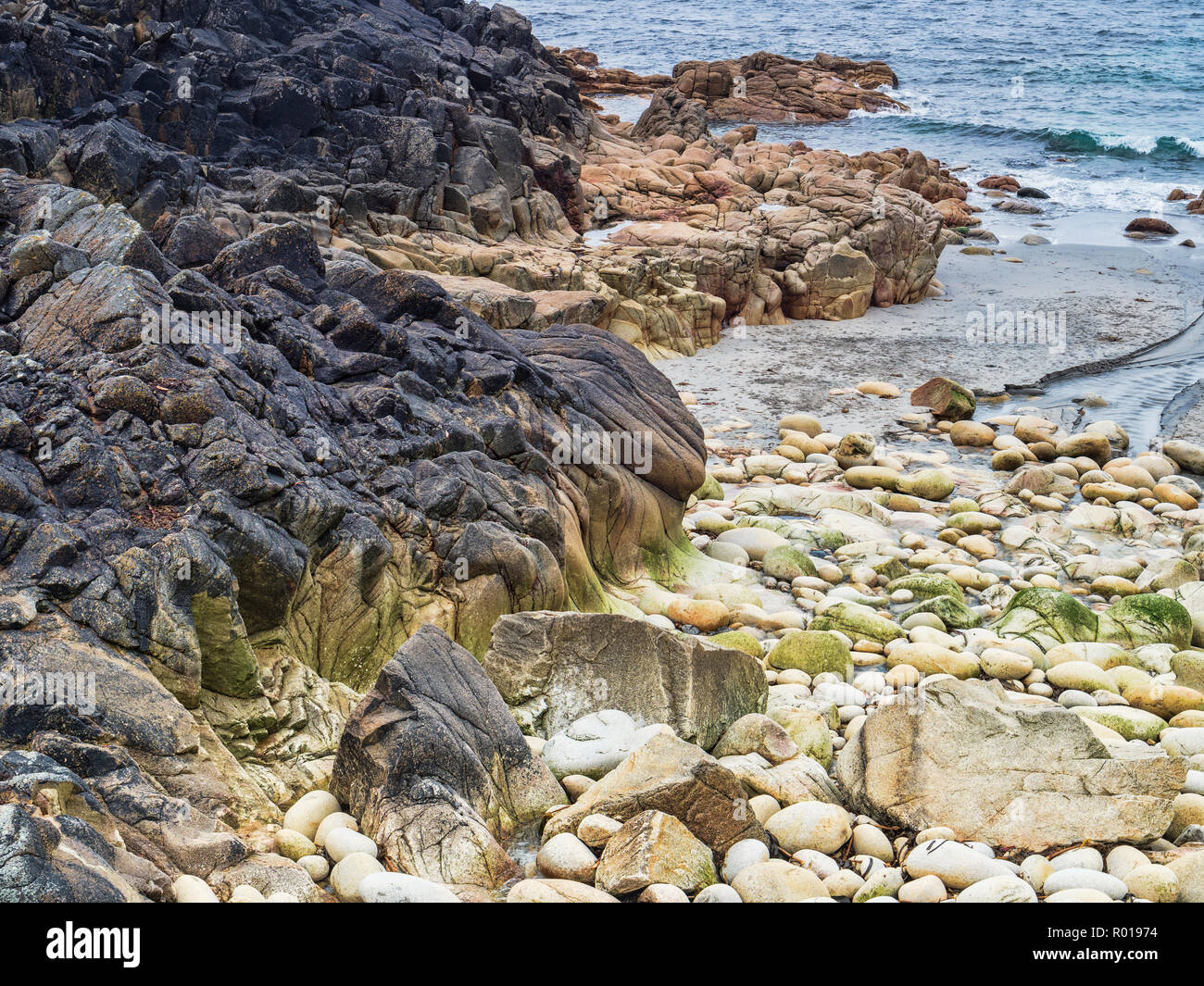 Porth Nanven Beach, sometimes called Dinosaur Egg Beach beacuse of the round boulders covering the beach, Cornwall, UK - Stock Image