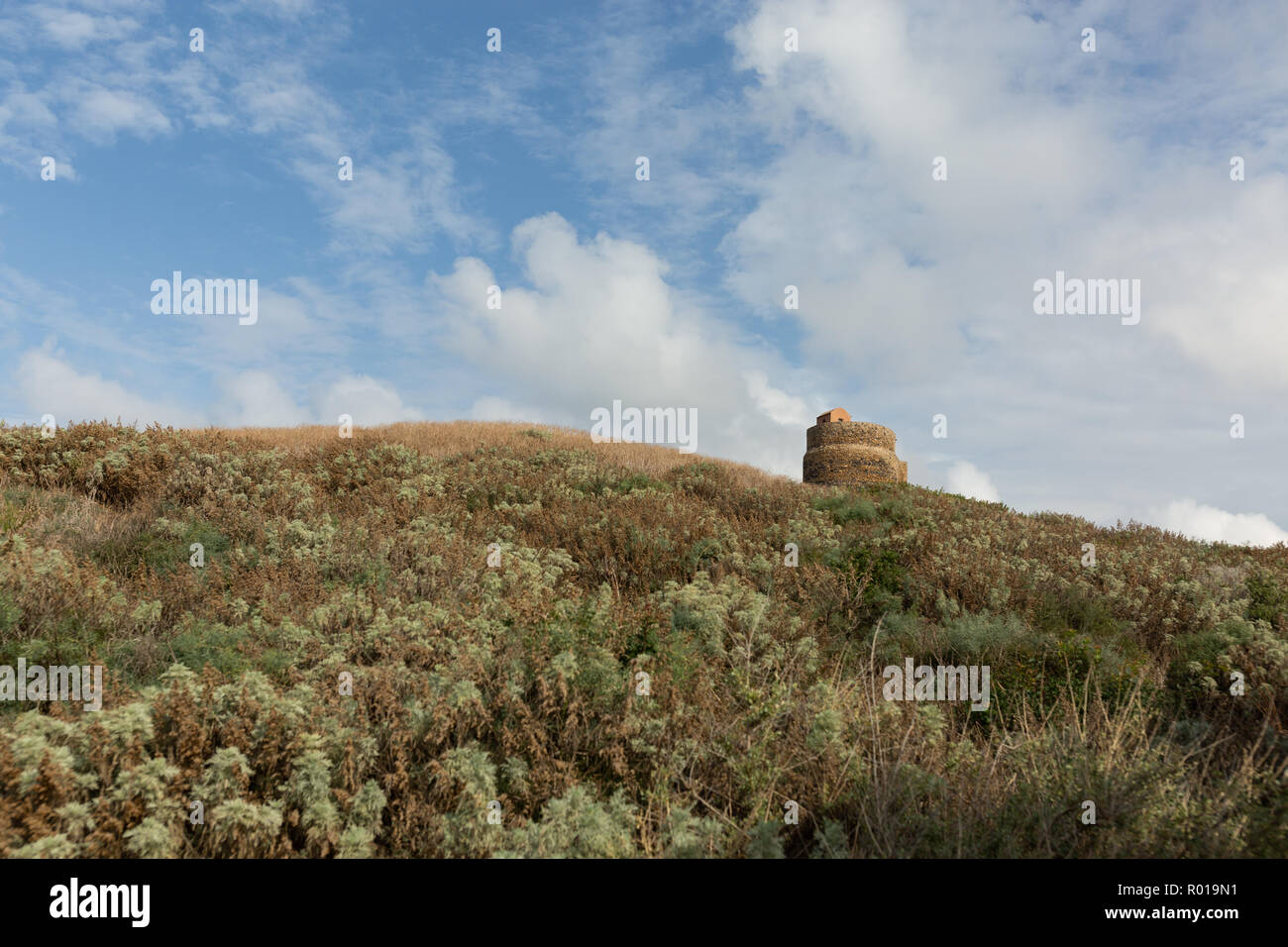 the 16th century Tower of Giovanni in the ruins of the ancient city of Tharros Stock Photo
