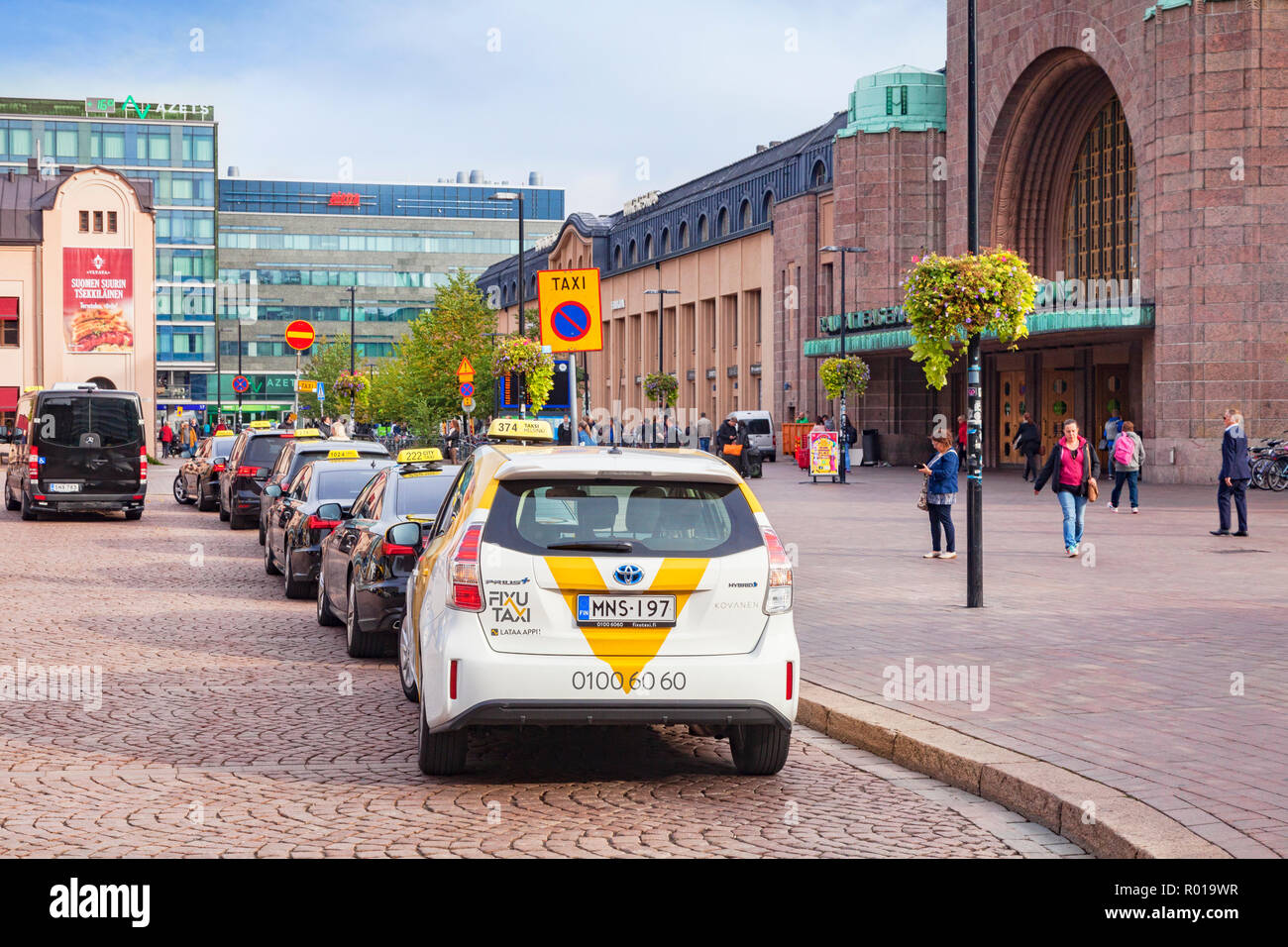 20 September 2018: Helsinki, Finland - Taxi cabs lined up at the railway station. - Stock Image