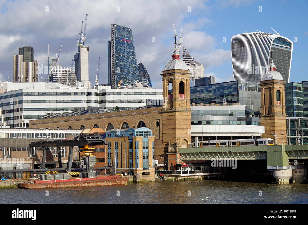 Cannon Street station and the river Thames seen from Blackfriars bridge, with office towers and construction cranes as a backdrop - Stock Image