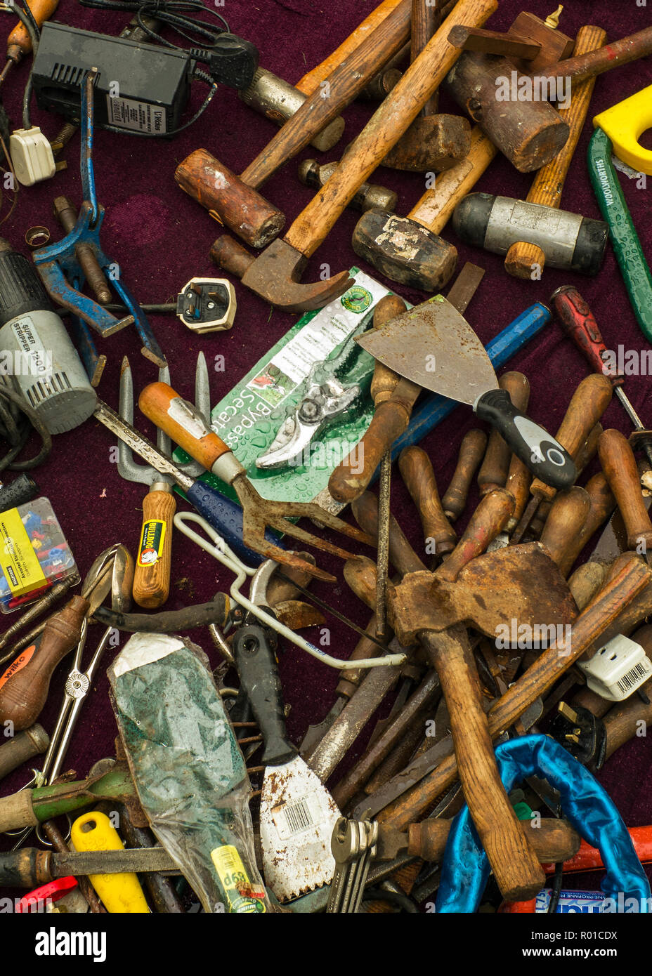 old hand tools layed out on ground,at jumble sale. - Stock Image