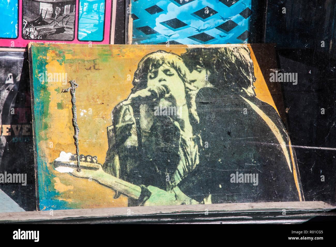 painting of keith richards and mick jagger,in window of second hand record shop, camden market, - Stock Image