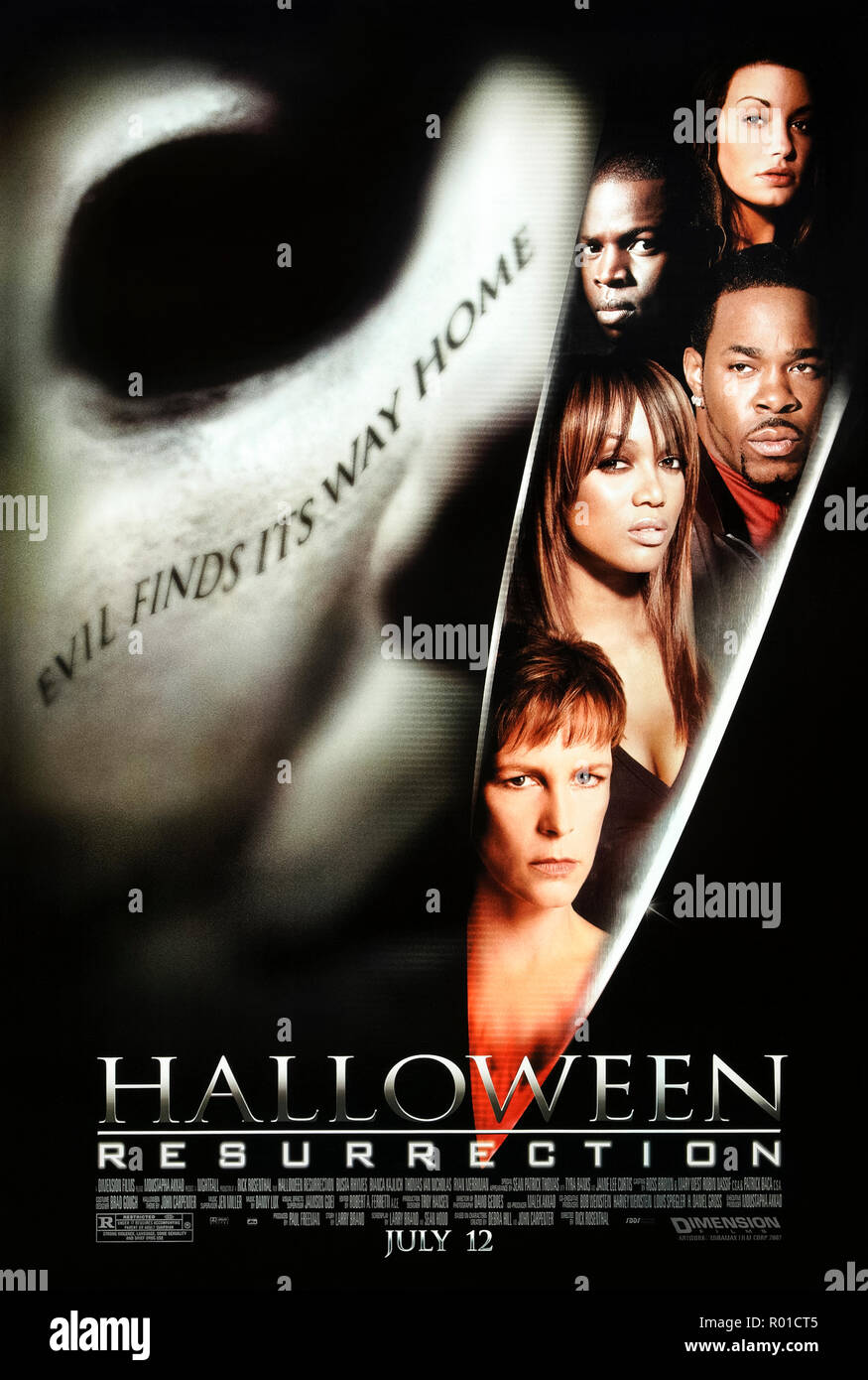 Halloween: Resurrection (2002) directed by Rick Rosenthal and starring Jamie Lee Curtis, Busta Rhymes, Brad Loree and Bianca Kajlich. Serial Killer Michael Myers returns to murder the contestants of a reality show. - Stock Image