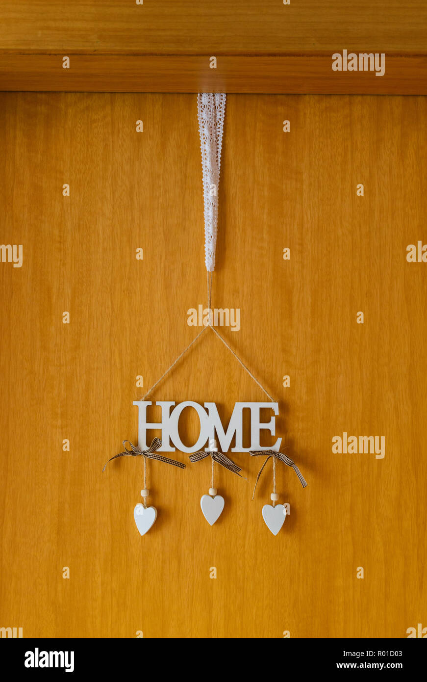 Decorative home word on an entrance door - Stock Image
