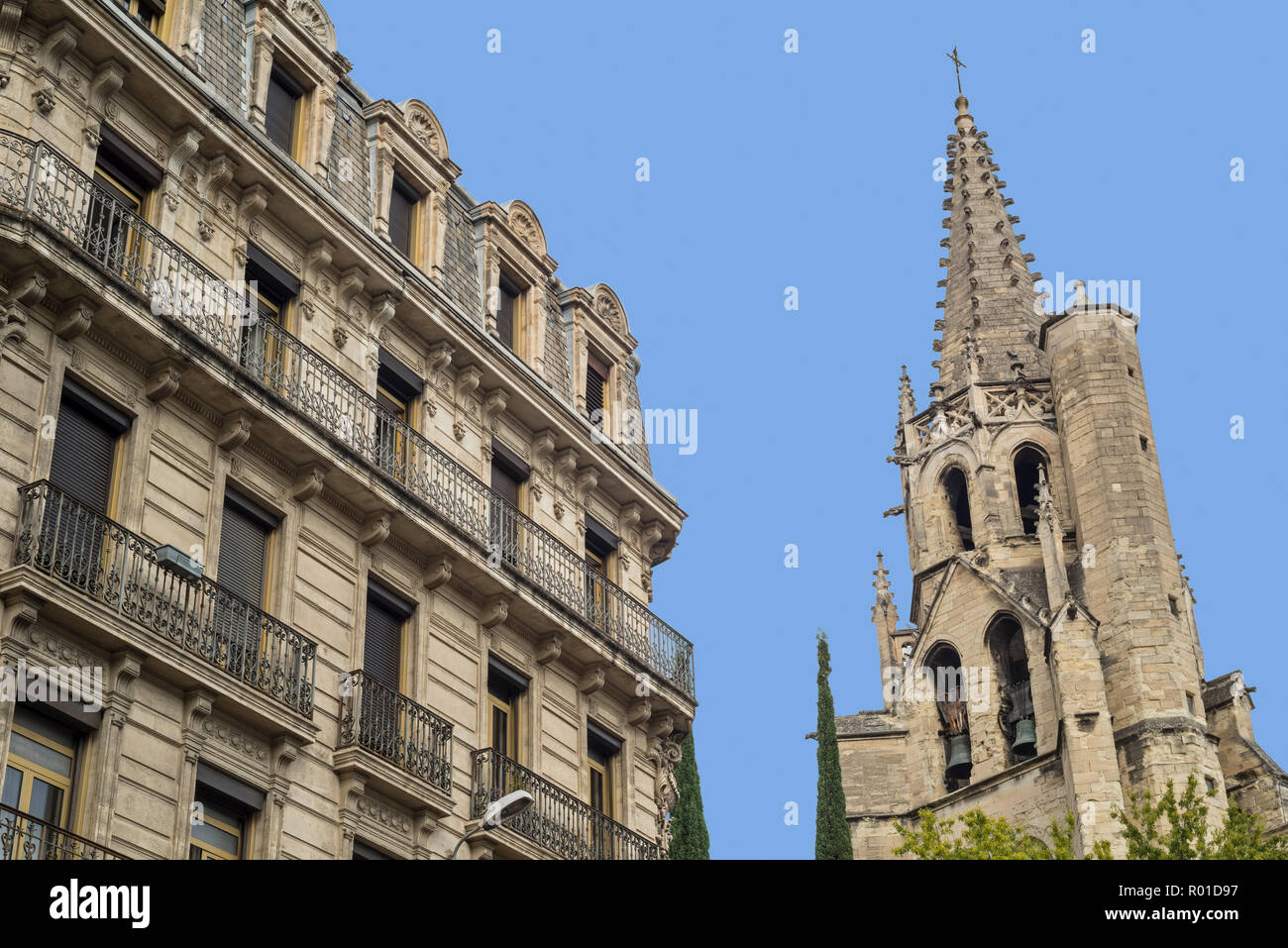 Belltower of the 14th-century Gothic Basilique Saint-Pierre d'Avignon / Basilica of St Peter, Avignon, Vaucluse, Provence-Alpes-Côte d'Azur, France - Stock Image