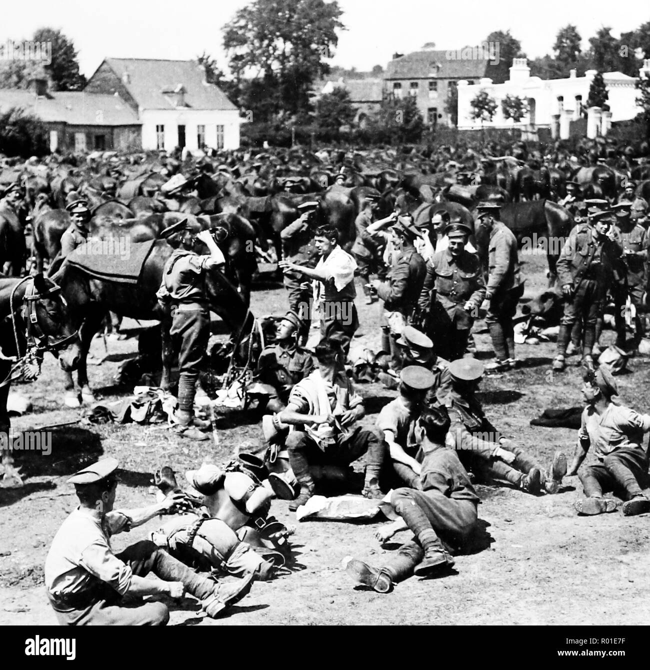 British cavalry resting in a French village during the First World War - Stock Image