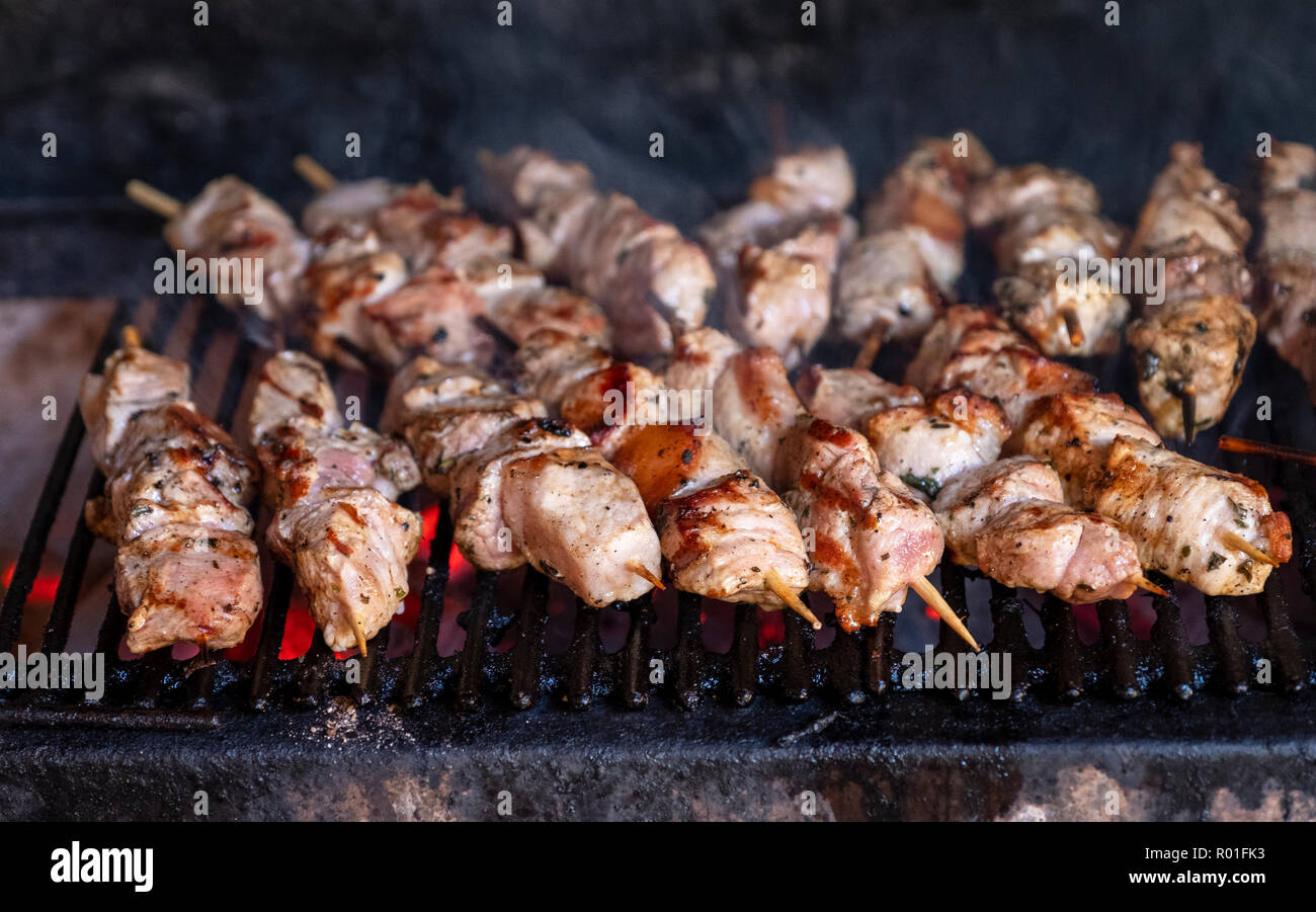 Pork kebabs cooking on a barbecue in the Lofou Taverna, Lofou village, Cyprus. Stock Photo